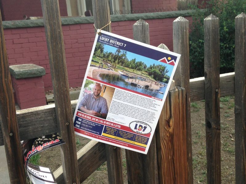 Image of Paper Newsletter on a fence